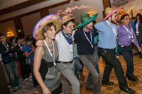 FiO/LS 2014 attendees dance at a southwestern themed reception.